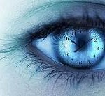 Picture of a woman's eye with a clock superimposed on iris.